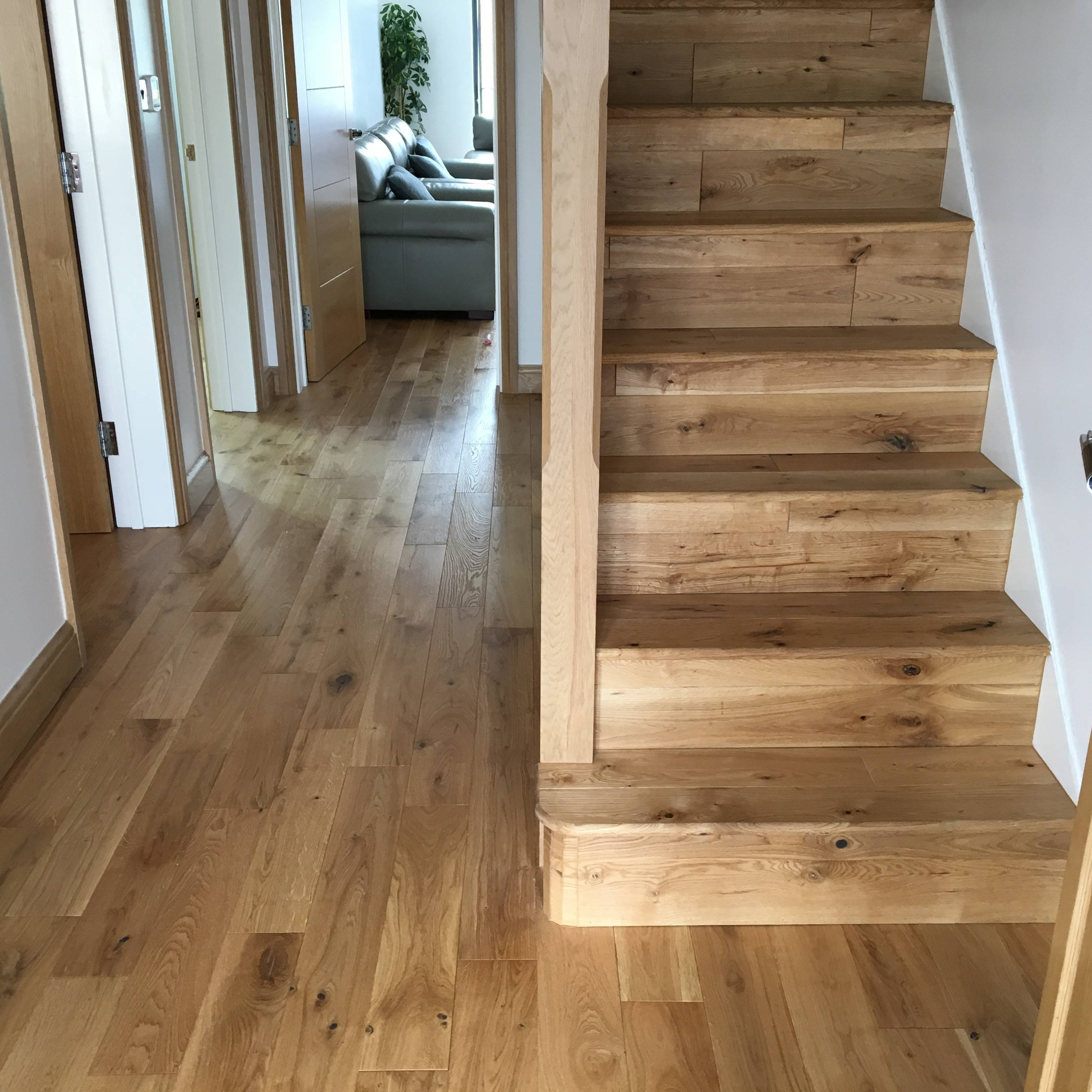 Solid oak flooring fitting job in hall and staircase